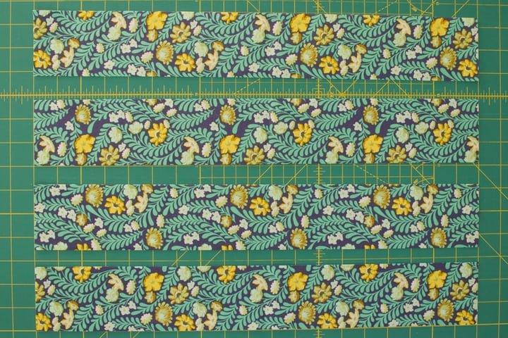 four pieces fabric cut for tiebacks