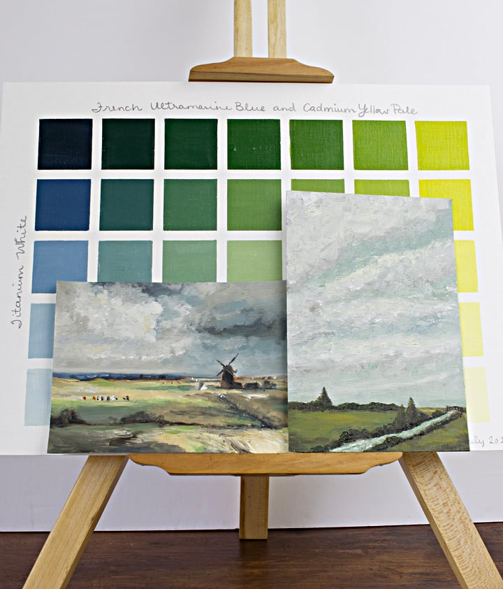 two paintings and colour chart on an easel