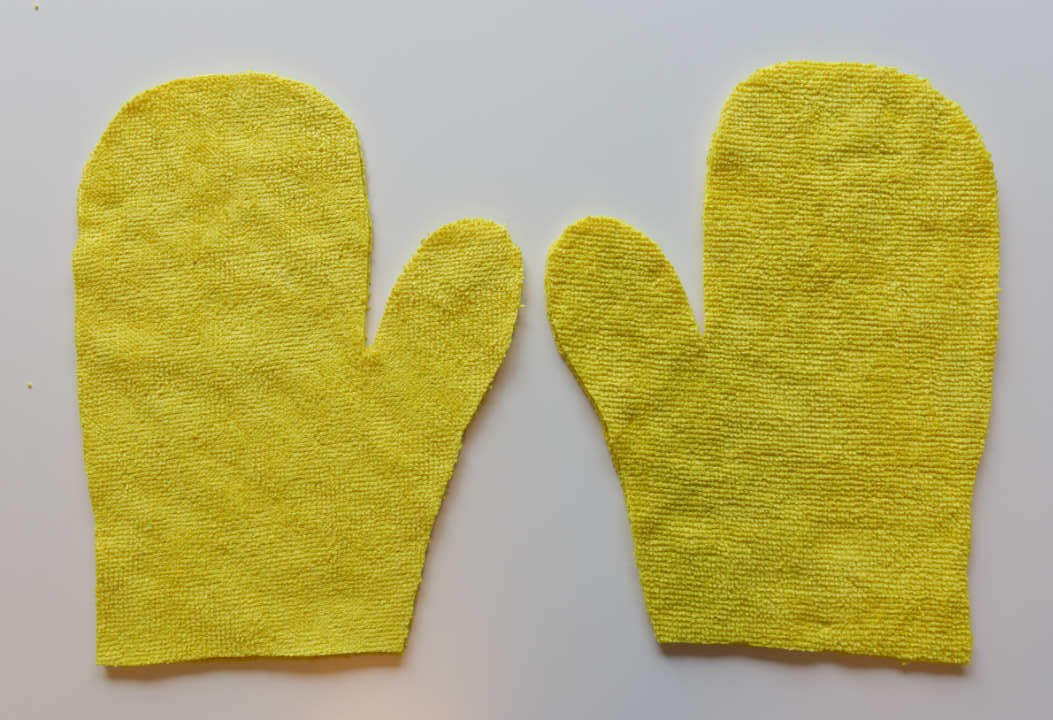 Two pairs of pieces have been cut to make 2 gloves