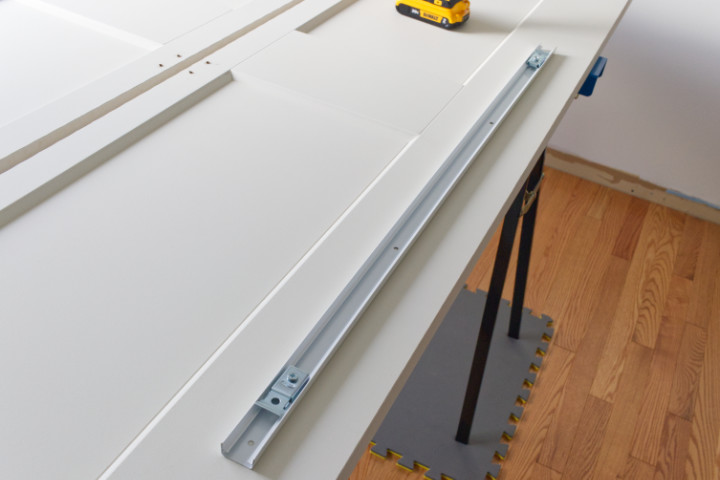 Bifold track with two top brackets