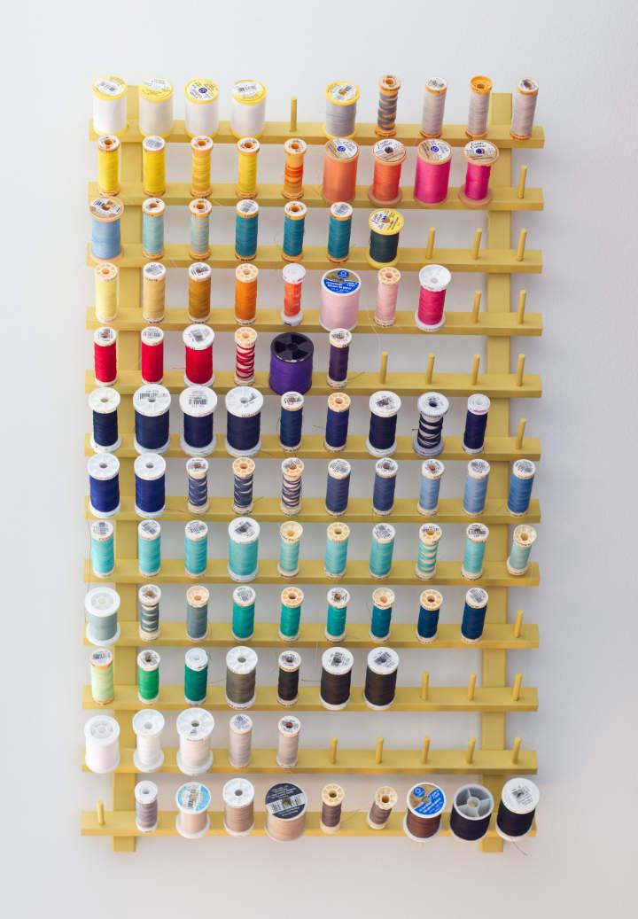 Colourful spools of thread on thread rack makeover