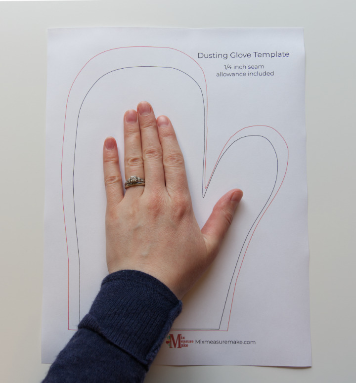 Hand on top of template for easy DIY plant dusting gloves to choose best size