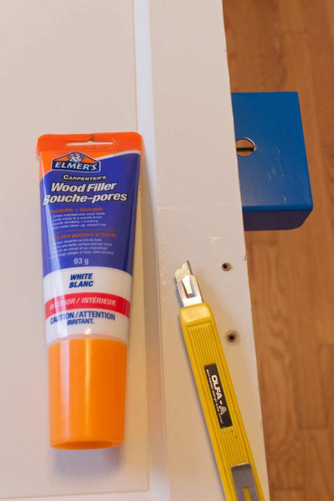 Wood filler and utility knife to clean up and fill holes