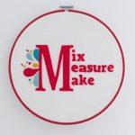 Finished Piece of Mix Measure Make Logo Hoop Art