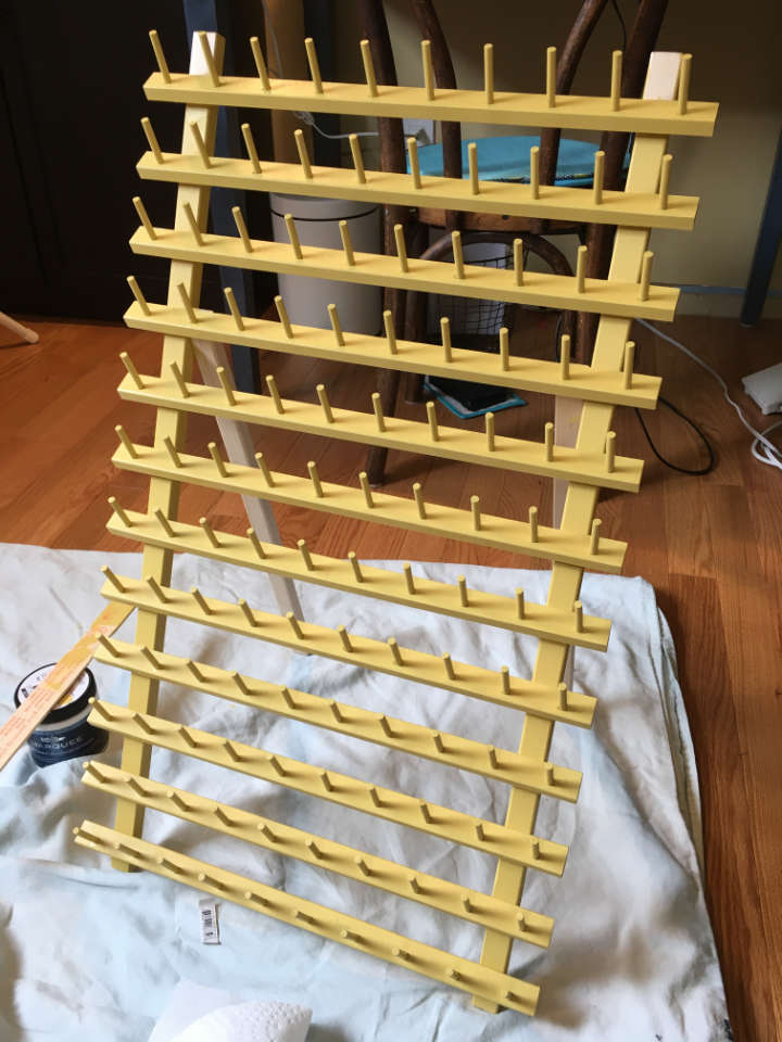 Thread storage makeover - the thread rack in the process of being painted yellow