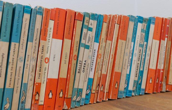 Vintage row of orange and turquoise penguin books