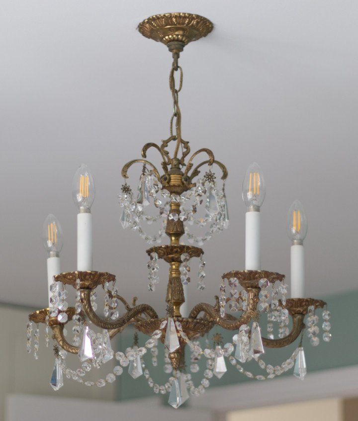 Reasons to buy vintage decor: Real patina and charm such as this real vintage Brass Chandelier with crystals