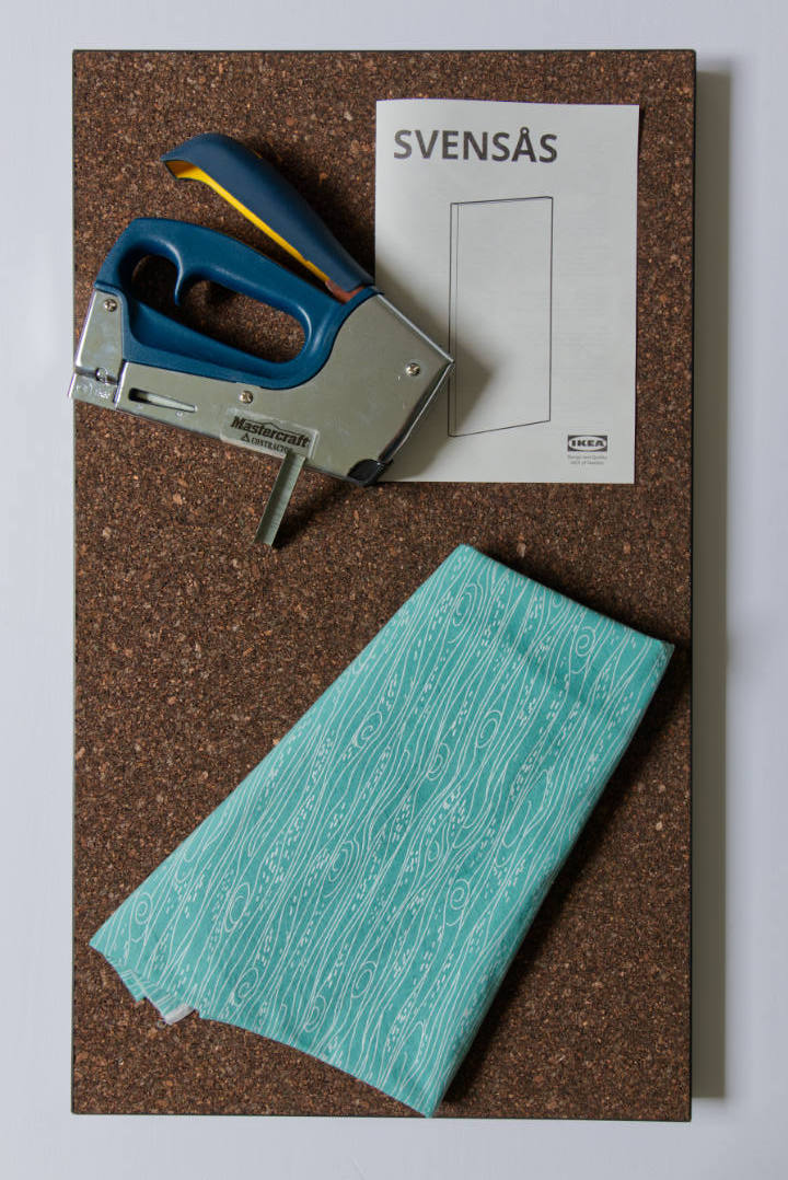 Required Materials: Bulletin board with fabric, staple gun, and staples on it.