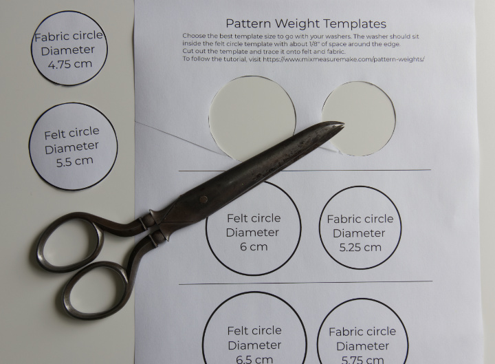 The correct size of pattern weight templates have been cut from the sheet, scissors lay on top