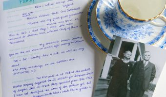 Family Heirlooms journal sheet filled out beside teacup and photograph