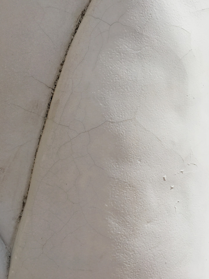Visible surface cracks on the flat surface of the plaster tulip garden sculpture