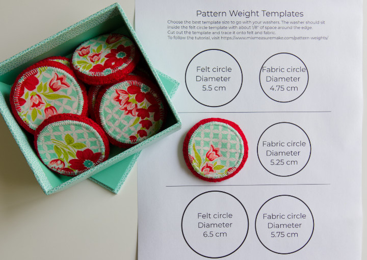 Set of red and aqua floral pattern weights in a box and one laid one medium pattern weight template