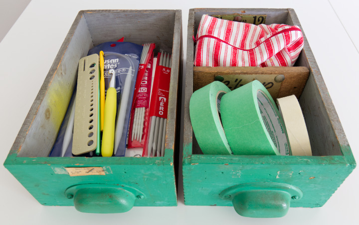 Two vintage drawers painted bright green and filled with knitting, crochet and quilting tools