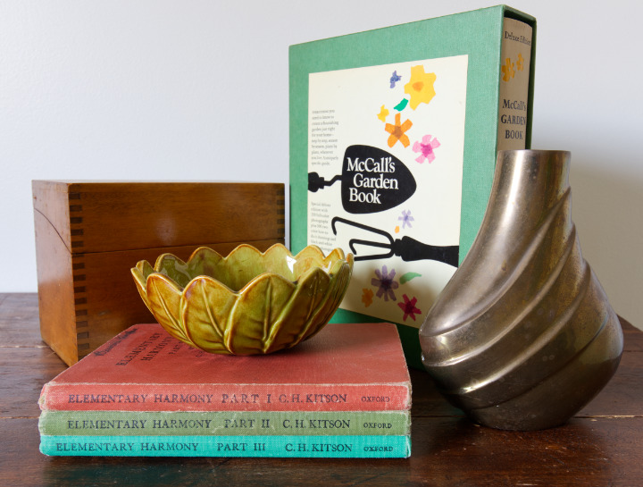 A wooden recipe box, a gardening book, a stack of 3 colourful vintage books about music theory, a little ceramic leaf bowl, and an interesting shaped antique brass vase, all purchased for less than $4 each