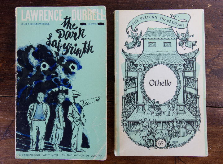 Two graphic paperback novels with black, white and aqua covers