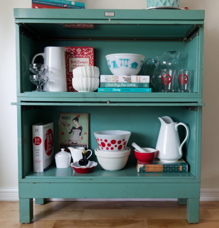 Vintage and new kitchen items in the barrister bookcase like a China cabinet