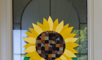 A DIY Fall sunflower hanging on a front door