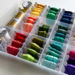 A shot of the neat rainbow floss on bobbins in the organizer box