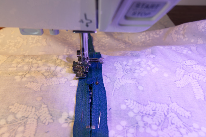 Sewing down the zipper towards the zipper pull, and pausing