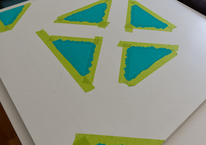 First triangles taped with painter's tape and painted with turquoise paint