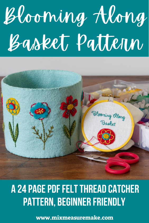 Blooming Along Basket Pattern - embroidered felt basket Pinterest Graphic - image of aqua felt basket with colourful flowers next to small embroidery hoop and red scissors