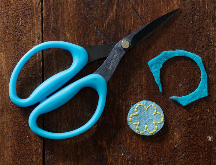 """Aqua """"Perfect Scissors"""" sit beside the flower piece that has been cut out from the felt and ready to soak"""