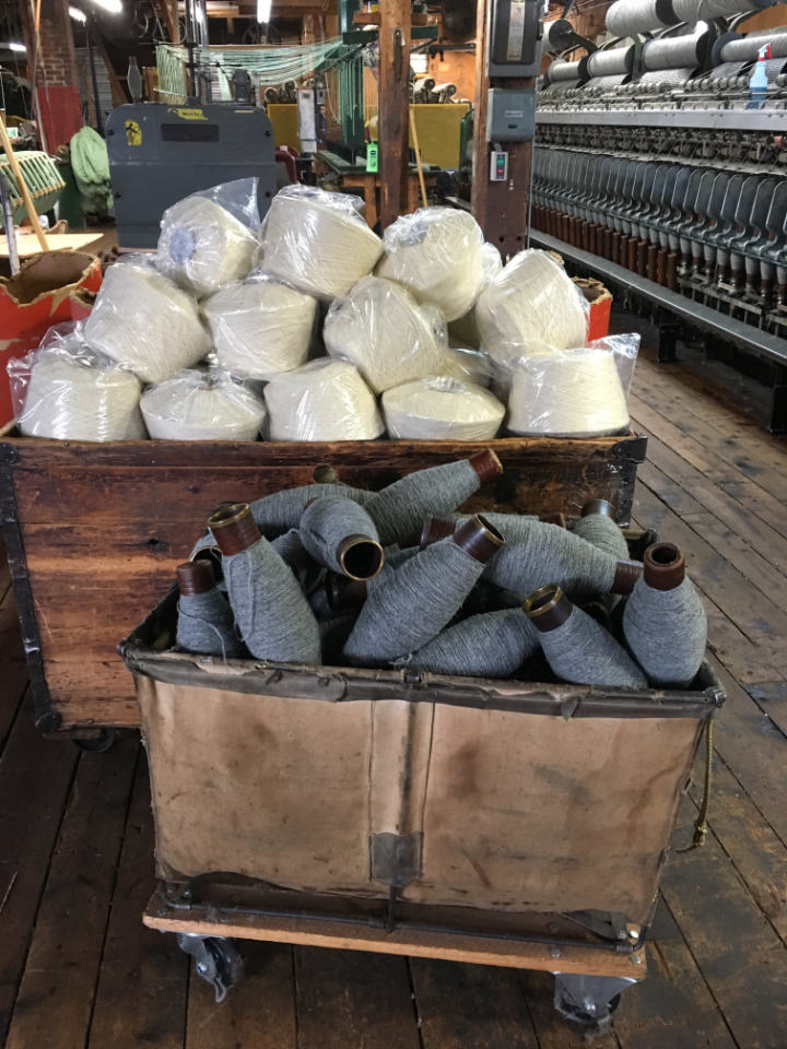 Industrial style carts in the woollen mill full of bobbins of wool