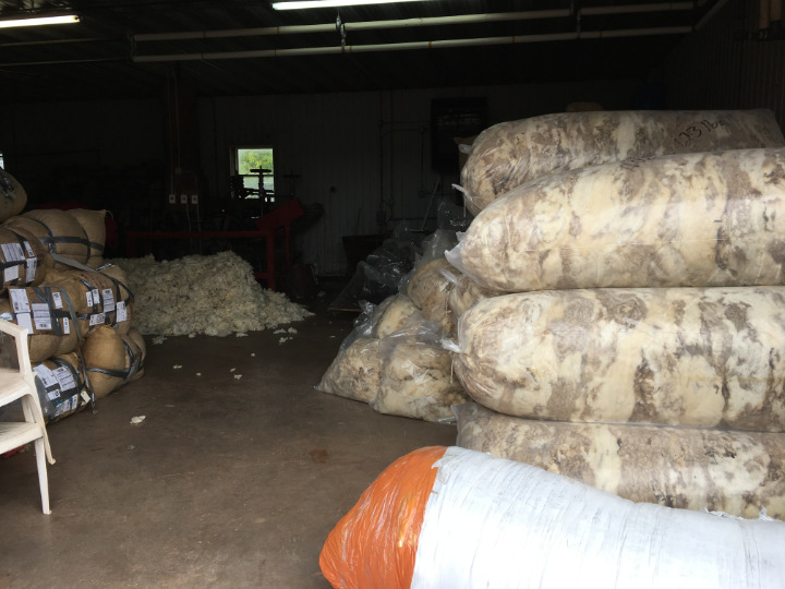 A warehouse part of the mill where very large bags of wool arrive that will be turned into Canadian wool blankets