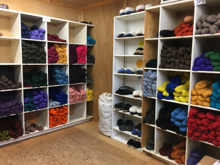 Shelves full of wool yarn for sale at the woollen mill in all sorts of colours