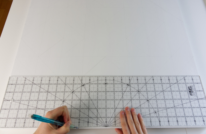 Marking every 3 inches with the quilting ruler on the edge of the barn quilt with a pencil