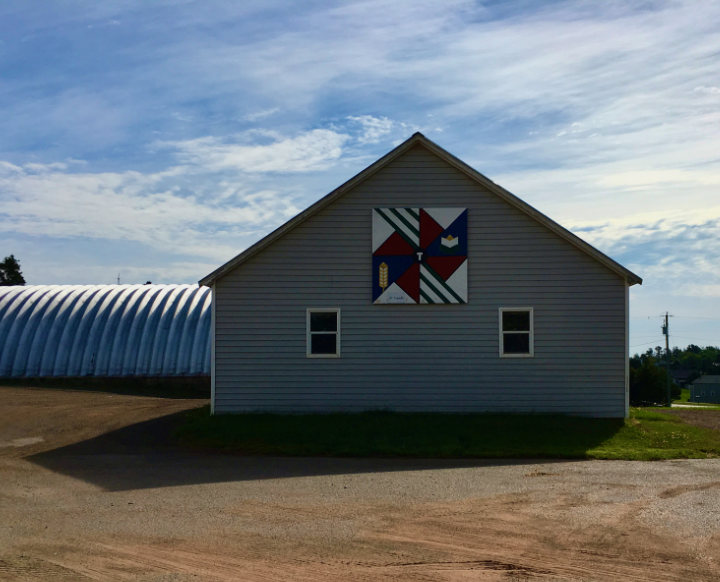 A symbolic barn quilt on a barn on PEI