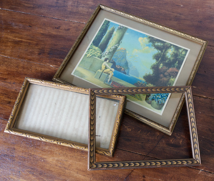 Three small vintage frames, all sort of gold, one has art in it, one a cardboard backing, and one is just the frame - useful summer vintage finds