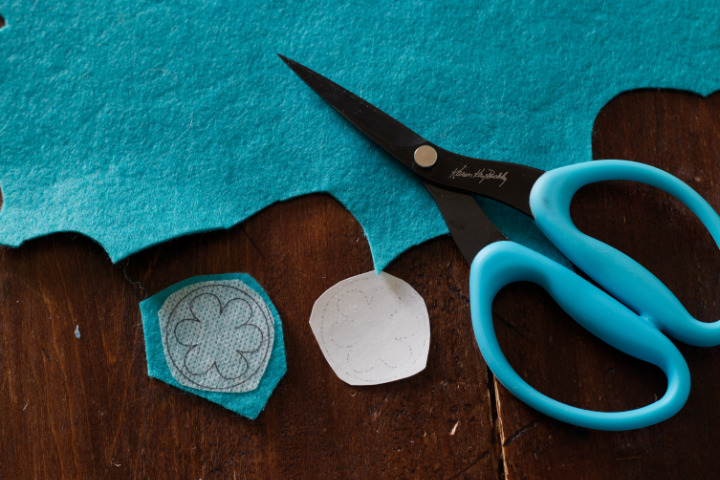 """Aqua """"Perfect Scissors"""" sit beside turquoise felt and the stabilizer backing has been removed and the flower image stuck to a piece of turquoise felt"""