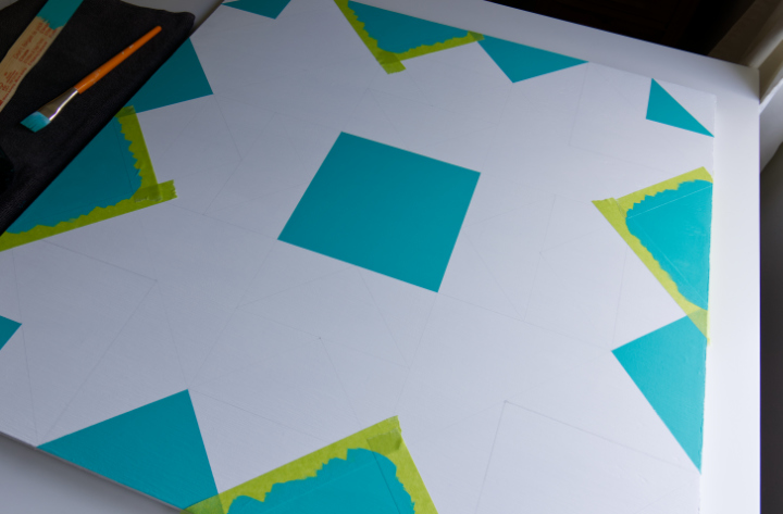 Painting turquoise sections on the orange barn quilt