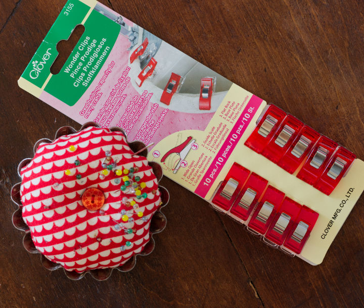 Red Wonder Clips and a pin cushion with pins
