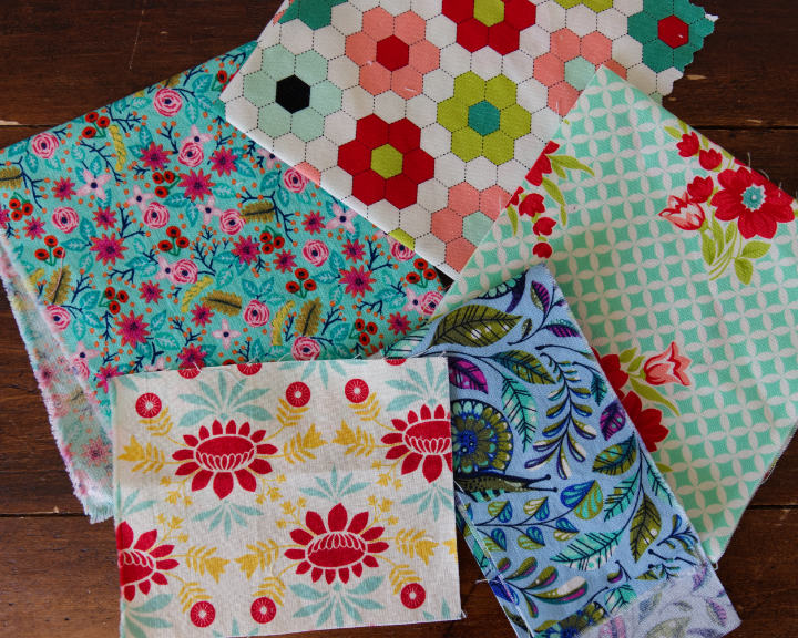 5 different multi coloured quilting cottons, mostly florals with bright contrasting colours to inspire your felt colour scheme