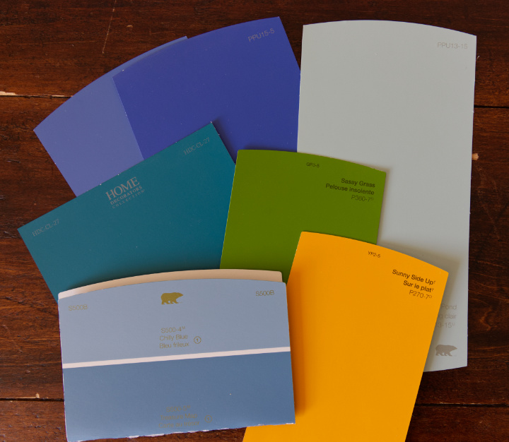 A selection of paint chips in blues, teal, green, yellow, and aqua to inspire your felt colour scheme