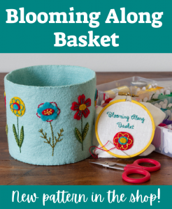 Blooming Along Basket - New Pattern in the shop - image of thread catcher basket of aqua felt with gold, turquoise and red flowers next to scissors and floss